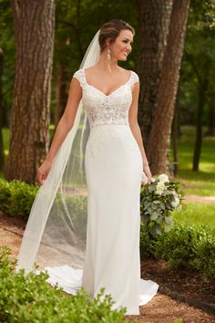 Grecian column wedding dress with high lace neck and illusion back.