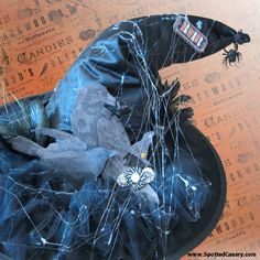 This DIY wicked witch hat is wrapped in webs and decked with creepy crows and spiders. #spottedcanarycontest