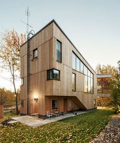 This wooden home in Helsinki has a kinked plan that wraps around a secluded garden