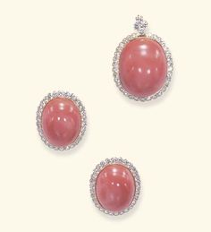 A SET OF CORAL AND DIAMOND JEWELRY, BY VAN CLEEF & ARPELS   Comprising a pendant, designed as a cabochon coral plaque, within a circular-cut diamond surround, suspended from a circular-cut diamond bail; and a pair of ear clips en suite, mounted in 18k gold, with maker's marks  Pendant signed VCA for Van Cleef & Arpels, no. 143.804; ear clips signed monture VCA, no. 143.803; each with maker's marks for Van Cleef & Arpels