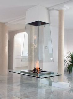 This stunning Glass Fireplace by Bloch-Design lets the natural beauty of fire take center stage. Safely contained within a glass fireplace enclosure, you will want to sit and relax by the fireplace for a long time. This is modern design at its best. Luxury Interior, Interior Architecture, Interior And Exterior, Fireplace Design, Fireplace Glass, Fireplace Ideas, Gas Fireplace, Suspended Fireplace, Floating Fireplace