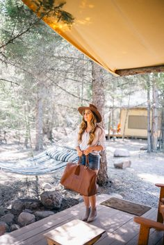 Gal Meets Glam Glamping In Montana -Velvet by Graham & Spencer shirt, Levi's shorts, Sole Society booties c/o, Sole Society bag c/o & Charlie Horse Hat