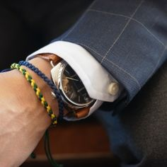 """Braided """"Friendship"""" bracelet, a great counterpoint for a classic watch."""