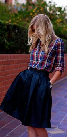 WAYS TO WEAR PLAID THIS SEASON! There are so many great ways to style those plaid button down blouses for fall and winter. We're loving this plaid with a midi skirt. Creates a more casual look that is still super fab!