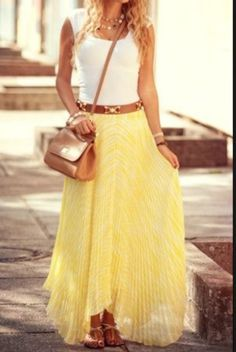 Adorable yellowish maxi skirt, white top, brownish belt, bag, and sandals... Probably the best way to wear yellow.