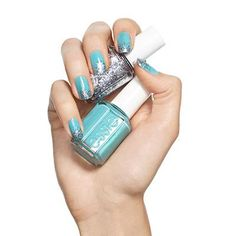 glisten up by essie - a sea of aqua blue ices over with a glittery silver gradient in this fiercely frosty nail design.