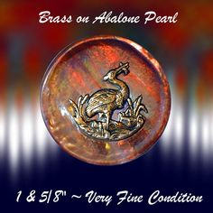 19th C. Red Abalone Pearl with Brass Crane Escutcheon  ~ R C Larner Buttons at eBay  http://stores.ebay.com/RC-LARNER-BUTTONS