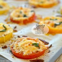 Cheesy Baked Tomatoes are a simple and easy side dish or appetizer that will please the entire family! Delicious and savory, with fresh basil!