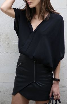 Black mini, black sheer blouse.