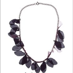 Lanvin Flower Petals and Amethyst Long Necklace Flower petals are dark purple and wine color. The intermitent crystals are amethyst. Lobster claw clasp with signature Lanvin ball charm. In perfect condition! Comes with dustbag. Lanvin Jewelry Necklaces