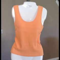Ralph Lauren 100% Cotton Tank Top Beautiful Orange Tank Top by Ralph Lauren.  100% Cotton. Size Medium. Laying flat Arm to Arm is 15.5.  The length is 22.5. Good condition with normal wear. Non smoking home.  ALL Offers through the offer button only. Ralph Lauren Tops Tank Tops
