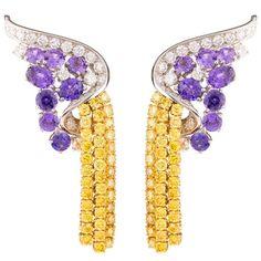 Van Cleef & Arpels, amethyst, yellow diamond and white diamond earrings.