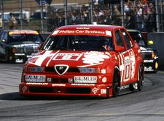 155 V6 TI DTM  This Deutsche Touren-wagen Meistershaft (DTM) 155 V6 has the distinction of being the first Alfa Romeo racing car to feature four-wheel drive.  Driven by Nicola Larini, the 2.5-litre V6 155 won 10 out of the 20 races and took the 1993 DTM Championship.  1993  Engine: V6-60°, 2498cc, 24 valves Power: 444 bhp @ 12000 rpm Top speed: 156-188 mph