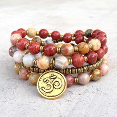 Crazy lace agate and red jasper, for joy and grounding, 54 bead mala necklace with an Om charm pendant. It wraps as a bracelet, (stringed on thick hi-tec elastic) and may be worn as a mid-length neckl