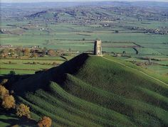 Glastonbury Tor, England  Watch people trogging up the hill, and then watch them coming down – singing, chatting, brightened and changed.  Why? Here are a few clues.  Glastonbury Tor is home to Gwyn ap Nudd, King of the Fairies.  Words from: http://www.glastonburytor.org.uk/