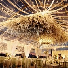 From the suspended flowers to the dramatic draping, this reception set-up makes us swoon.