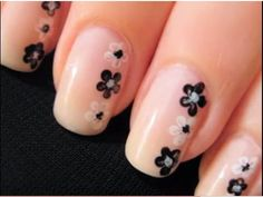 Nude pink with daisy nail art