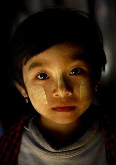 Myanmar  Girl with Thanaka makeup. Eric Lafforgue