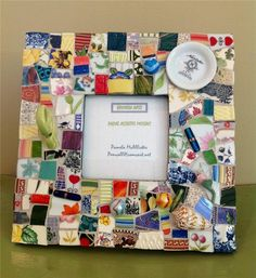Whimsical colorful Pique Assiette Mosaic picture frame. $58.00, via Etsy.
