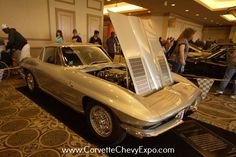 1963 Chevrolet Corvette Sting Ray owned by David & Mary Matlock.  It is on display at the 38th Corvette/Chevy Expo (2016) at the Galveston Island Convention Center, Galveston, Texas.  They received their President's Award this year at the Expo.  #1963corvette #pureart #splitwindow #chevy #chevrolet #vintagecar #classiccar #CorvetteChevyExpo #GalvestonIsland #picoftheday #corvette #c2 #sixties #sixtiesstyle #classic #vintage #vintagecar #spinners #showcar #carshow #stingray #nostalgia