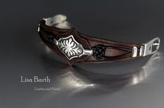 This piece was made with fine silver metal clay, and hand cut and dyed leather for the bracelet.  Lisa Barth