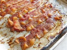 lay bacon on parchment on a rimmed baking sheet, and bake it right along with the French toast, in the oven. Bacon bakes beautifully: flat, golden brown, and straight