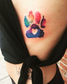 Watercolor paw print with the colors of my dogs birth stones