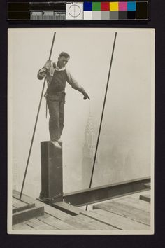 Steelworker standing on beam. Touching tip of Chrysler building