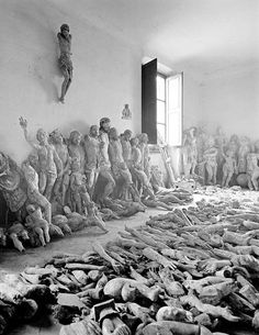 A storage room with salvaged effigies and sculptures awaiting restoration after a flood in Florence, Italy, in 1966 (photo by Balthazar Korab, 1926-2013)