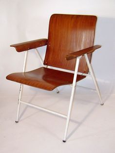 Russel Wright and John Adler; Bent Birch Plywood and Enameled Metal Folding Armchair for Samsonite, 1949.