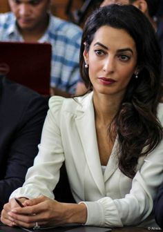 Amal Clooney. GUCCI. Creme Satin-Trimmed Crepe Pantsuit.   The one person I can find with my coloring.