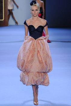It wouldn't be couture without a Lacroix meets tapestry pouf! Ulyanov Sergeenko creates my favorite in many seasons with a sharp nave bodice and peachy double tiered cake decoration of a skirt in tea length. J'adore.