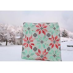 Here's my next finish!  We got so much snow on Christmas and while I'm not a fan of living (OR DRIVING) in it, it makes for pretty backdrops for quilt pictures! This is in our front yard, and my previous picture was in our backyard. I started this one back in September, and am pretty happy to have it checked off my list! ✔️ . . Pattern is Norway by @thimbleblossoms, fabric line is Handmade by Bonnie & Camille, and quilting is by @alatimer. Finish no. 23 of 2016. #MVhavequiltwilltrav...