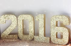 Welcome the new year with these beautiful gold glittered paper mache numbers! These numbers measure approximately 8 tall and are lightweight