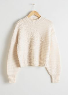 Front image of Stories mixed texture wool sweater in white Stickat 9380e6ae8e9a0