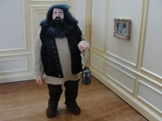 Marcia Backstrom, IGMA fellow - hand sculptured  Hagrid the Giant from Harry Potter. Hagrid is wearing brown pants with a tan shirt and black suede vest. He has jet black hair with a full black beard and mustache.  He holds a tin lantern in his hand. sold on ebay for $499