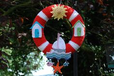 image of crocheted lifebuoy wreath with sea life themed motifs