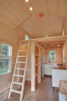 This 160 sq. ft. tiny house on wheels is built on a 20′ trailer designed and built by Tiny Living Homes. The trailer has a GVW of 12,000 lbs and a widened frame to better hold the weight of t…