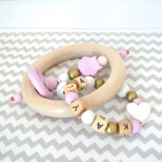 Personalized wooden teether wood toy baby rattle por orangeandcoco
