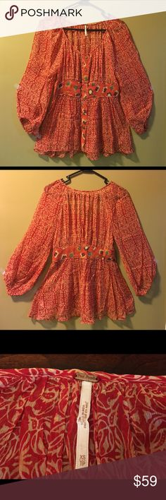 Free People Boho Print Top-Red/Tan, XS Free People Boho Print Top-Red/Tan, XS  This boho top is cute and unique with a mainly red and tan print with green and orange comes as well. It's super flowy and see-through, so wear a tank underneath. 😉 This would be great with jeans, shorts, or leggings and can also be used as a beach cover-up. Excellent like-new condition. ☺  Length-26 inches Bust- 32 inches (16 inches across) Material- 100% Viscose (Rayon) Free People Tops Blouses