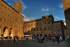 Piazza dei Priori, Volterra, A lovely, medieval square lined with austere buildings, among which the 13th century Palazzo Pretorio, linked with the Torre della Podesta' and Palazzo dei Priori, the present-day town hall, decorated with terracotta, marble and stone coat of arms of the Florentine governors. Engraved between the banner and torch holders, is also the canna volterrana, the ancient unit of measurement of the commune.   Markets have been held on Piazza dei Priori since AD 851.