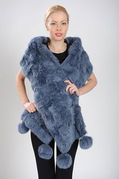 Blue long scarf of rabbit fur with pom poms. Available for wholesale orders.