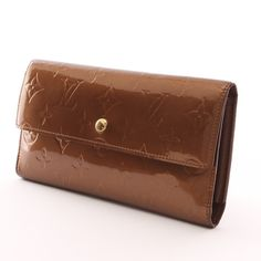 """Sehr edle Geldbörse von Louis Vuitton in Bronze - Modell: """"Sarah"""""""