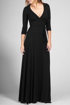 Rachel Pally's Long Wrap Dress in black.  A FLOOR-SWEEPING , LONG SLEEVE WRAP DRESS WITH WAIST-TIE DETAIL. A CLASSIC AND EASY OUTFIT!