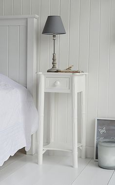 Narrow Nightstand new england white beside table with silver handle. a tall narrow