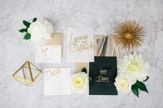 """Invitations are the first chance to really set the scene for your wedding, so let your theme shine through. """"This bride had impeccable taste. Adding a soft, curved marble pattern and metallic accents gave the clean, modern invitation suite by Nic Roc Designs a feminine feel,"""" says Carissa Jones of JL Designs.Related: 50 Ideas for Your Wedding Invitations"""
