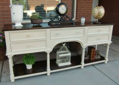 This is a solid oak buffet that has been upcycled with Java Gel Stain on the top as well as the bottom shelf. The body and drawers are painted with Annie Sloan Chalk Paint in Old Ochre, sealed in Clear Wax, and I have replaced the original brass pulls with antique glass knobs