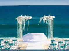 Oh my god. Wow. Lucite ceremony structure with draping white phalaenopsis orchids #Beach #Wedding #Decor