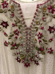 A floral fiesta on the yolk with a meticulous choice of threads that add to the grandeur of this indian outfit. This one could be a show stopper at an elite gathering. Zardosi Embroidery, Embroidery On Kurtis, Hand Embroidery Dress, Kurti Embroidery Design, Embroidery Fashion, Hand Embroidery Designs, Floral Embroidery, Beaded Embroidery, Pakistani Fancy Dresses