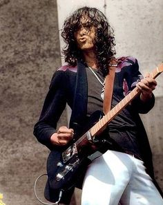 "Jimmy Page..He's one of the only musicians that can do that ""lips thing"" and look awesome!"